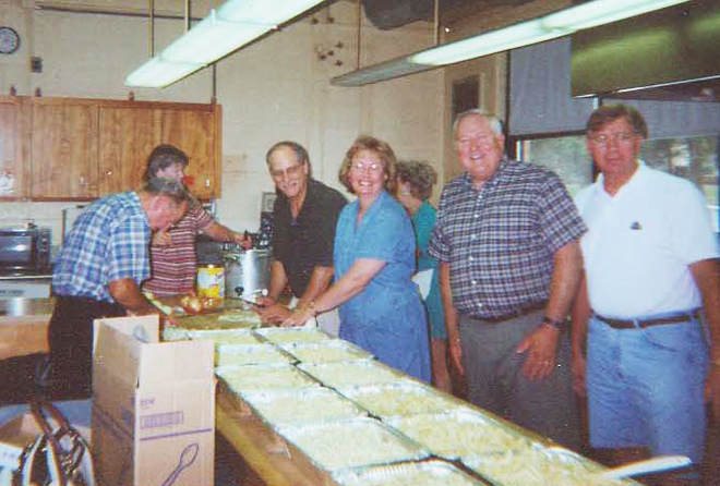 "Volunteers working the ""Casserole Program"""