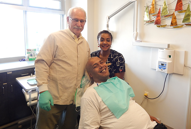 Dr. Martin with his assistant and a patient
